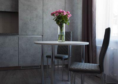 Kitchen, table, chairs, window. Suite room in Sumskaya Apartments, Kiev, Ukraine.