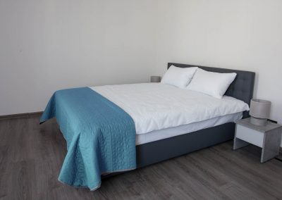 Bed. Junior room in the hotel Sumskaya Apartments, Kiev, Ukraine.