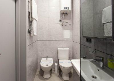 Toilet in the bathroom. Suite room in Sumskaya Apartments, Kiev, Ukraine.